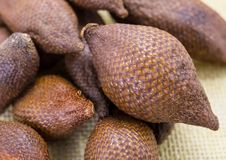 Sweet tropical fruits of palm greens, snake fruit with peel Royalty Free Stock Image