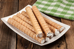 Sweet tube with whipped cream. Stock Images