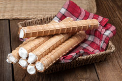 Sweet tube with whipped cream. Royalty Free Stock Image