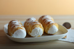 Sweet tubes filled egg white, Czech confection called Kremrole. Royalty Free Stock Photography