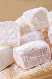 Sweet turkish delight on a timber board Royalty Free Stock Image