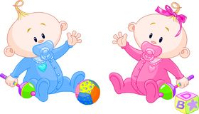 Sweet twins. Twin Baby Boy And Girl playing with rattles