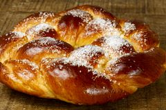 Sweet twist bread on rustic wooden table Royalty Free Stock Photos