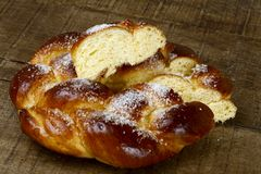 Sweet twist bread on rustic wooden table Stock Images