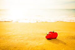 Sweet two heart on sand beach under sunset and warm light. Stock Photo