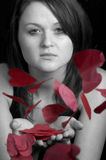 Sweet Valentine. Portrait of a pretty young woman with hearts Royalty Free Stock Photos