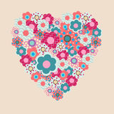 Sweet Valentine heart from decorative flowers on a pink backgrou. Sweet Valentine heart from a decorative flowers on a pink background Royalty Free Stock Images