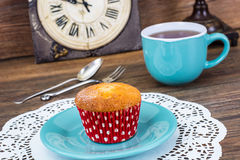 Sweet vanilla cake and tea in blue mug. Studio Photo Royalty Free Stock Image