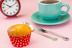 Sweet vanilla cake and tea in blue mug. Studio Photo Stock Photo