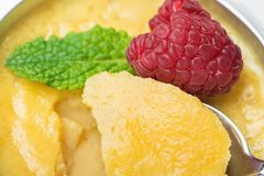 Sweet Vanilla Egg Custard Cream Flan with Fresh Raspberry and Mint in Portion Cup Scooped with Teaspoon. Macro Food Photography. Visible Creamy Texture and Royalty Free Stock Photography