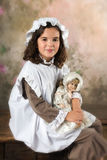 Sweet victorian girl. Posing in the old style Stock Images