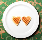 Sweet wafer heart. On dish, on retro background Stock Photography