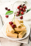 Sweet wafer rolls with cherries Royalty Free Stock Image
