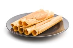Sweet wafer tubes. Sweet wafer tubes isolated on white background royalty free stock photo