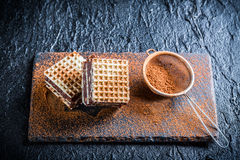 Sweet wafers with chocolate and hazelnut on stone plate Royalty Free Stock Photos