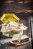 Sweet wafers with nuts and chocolate in old box Stock Photography