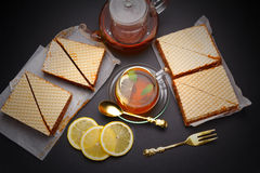 Sweet waffle triangular cakes with condensed milk Royalty Free Stock Photography