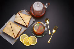 Sweet waffle triangular cakes with condensed milk Royalty Free Stock Images