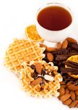 Sweet waffles with chocolate, nuts and a cup of te Royalty Free Stock Image