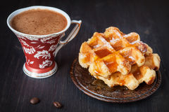 Sweet waffles with honey and coffee Royalty Free Stock Image