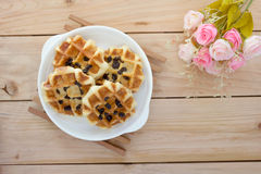 Sweet waffles with rose bouquet Stock Photos