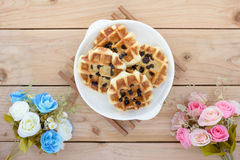 Sweet waffles with rose bouquet Royalty Free Stock Photo