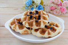 Sweet waffles with rose bouquet Royalty Free Stock Photography