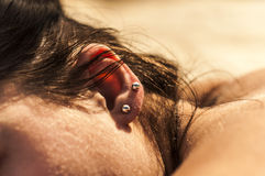 Sweet warm skin. My beautiful warm skin...body piercing Stock Photo