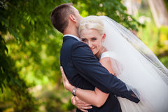 Sweet wedding, the bride and groom in an embrace Stock Image