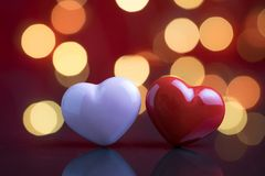 Sweet wedding romantic night, anniversary or valentine`s day concept, happy mini pink and red heart shape with dark background an. D beautiful light bokeh stock photos