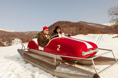 Sweet and weird couple surfing on a pedalos in winter time ( not Royalty Free Stock Image