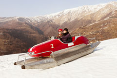 Sweet and weird couple surfing on a pedalos in winter time ( not Royalty Free Stock Images