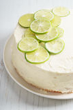 Sweet white buttercream cake with sliced lime on top Stock Photo