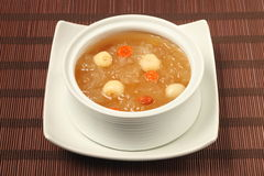 Sweet white fungus and lotus seeds soup. Chinese traditional dessert - Sweet white fungus and lotus seeds soup Stock Photo