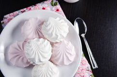 Sweet white and pink marshmallows on plate Stock Photo