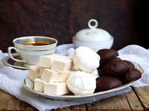 Sweet white Russian marshmallow, chocolate zephyr, meringue, apple pastila and cup of coffee on wooden background. Royalty Free Stock Photography