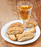 Sweet white wine and italian cantuccini on table Stock Photo