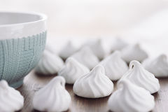Sweet white zephyr and cup of tea stock photography
