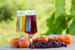 Sweet wine and fruits Stock Photos