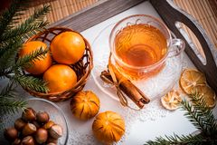 Sweet winter holidays background with various cookies and cup of hot spicy black tea on dark rustic table Stock Photos