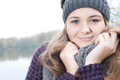 Sweet winter smile. Young teenage girl is having a nice time in the cold november royalty free stock photos