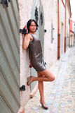 Sweet woman with beautiful legs in Old Riga Stock Photography