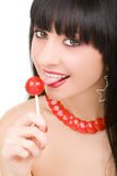 Sweet woman with candy Royalty Free Stock Photography