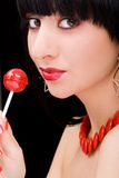 Sweet woman with candy Stock Photos