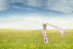 Sweet woman with fabric at field Stock Photography