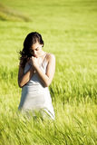 Sweet woman on field Royalty Free Stock Photography