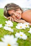 Sweet woman with flowers Stock Photo
