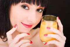 Sweet woman with glass of juice Stock Image