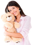 Sweet woman with a teddy bear Royalty Free Stock Photos
