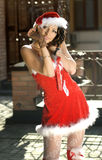 Sweet woman wearing santa claus clothes Royalty Free Stock Images